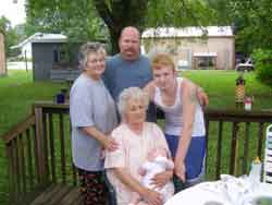 L-R Back: Gloria Faye (Fleming) Kaelin, Eulis Adams Jr and Eulis Adams III. Front: Opal Potter Fleming holding Christian Isaah Adams. 5 Generations